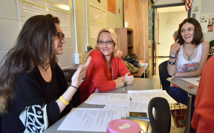 September 15, 2016 Dunwoody - Natalie Williams talks with her students Shelly Caplan (left), and Shira Kopel (right), both 17, during their creative writing class at Dunwoody High School on Thursday, September 15, 2016. Nathan Williams taught 12 years, the last two at Dunwoody High School. This year, students would meet Natalie. Still the same person, she says, as the transition won't change her personality, only shape. HYOSUB SHIN / HSHIN@AJC.COM